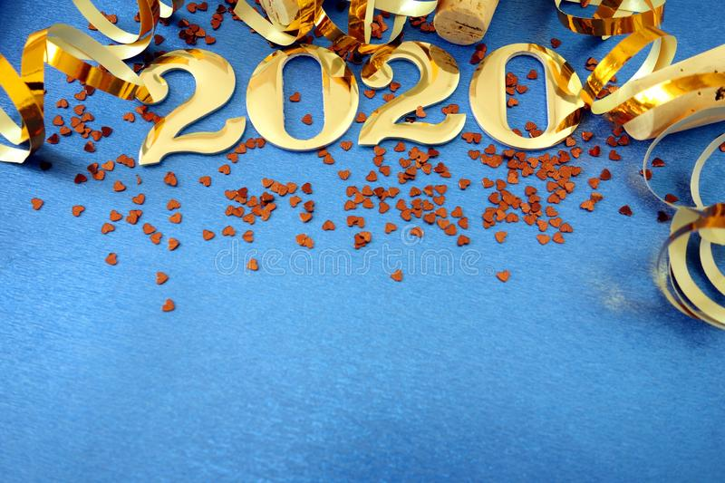 Happy New Year 2020. Symbol from number 2020 with decor on blue background royalty free stock photo