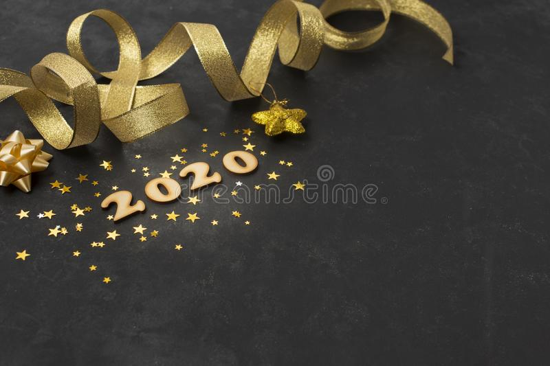 Happy New Year 2020. Symbol from number 2020 with decorations on wooden background royalty free stock image