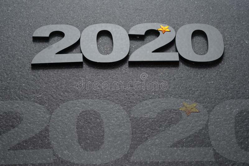 Happy New Year 2020. Symbol from number 2020 on stone background royalty free stock images