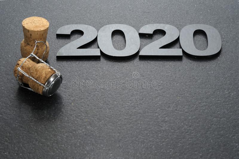 Happy New Year 2020. Symbol from number 2020 on stone background stock images