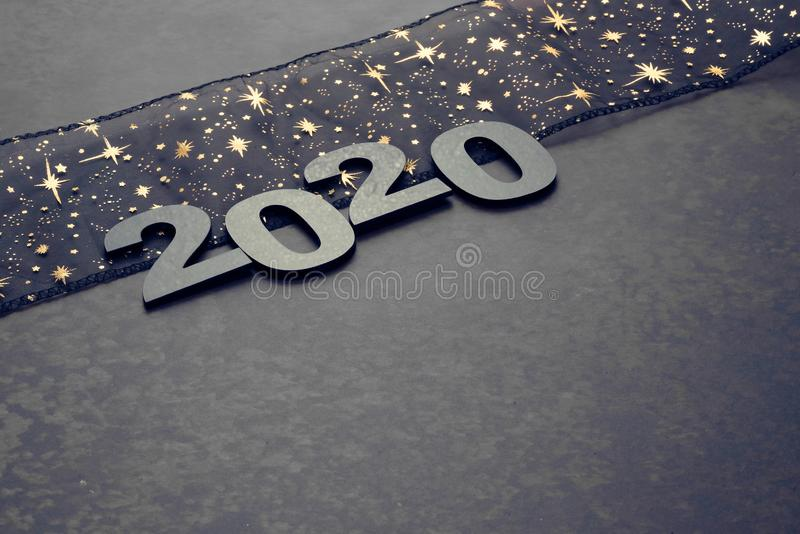 Happy New Year 2020. Symbol from number 2020 on stone background royalty free stock photography