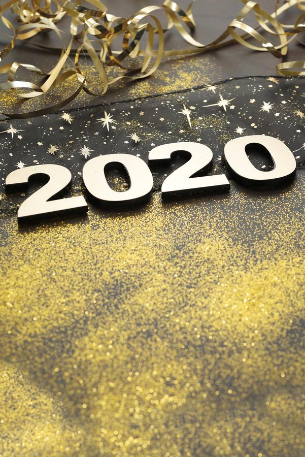 Happy New Year 2020. Symbol from number 2020 on stone background royalty free stock image