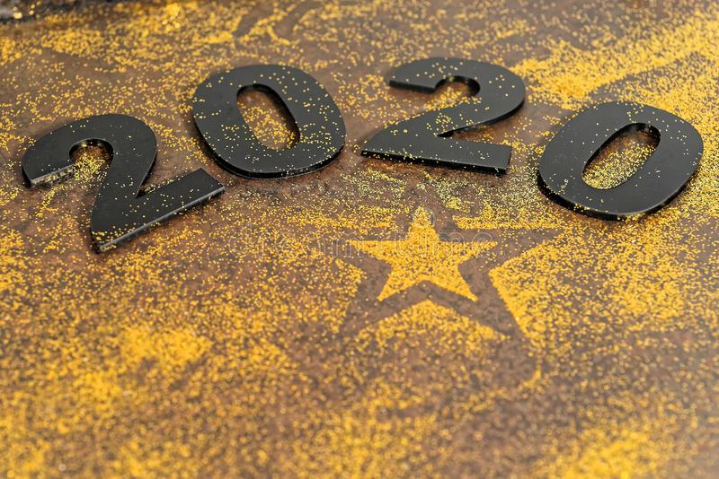 Happy New Year 2020. Symbol from number 2020 on stone background stock image