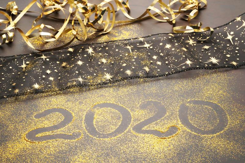 Happy New Year 2020. Symbol from number 2020 on stone background stock photos