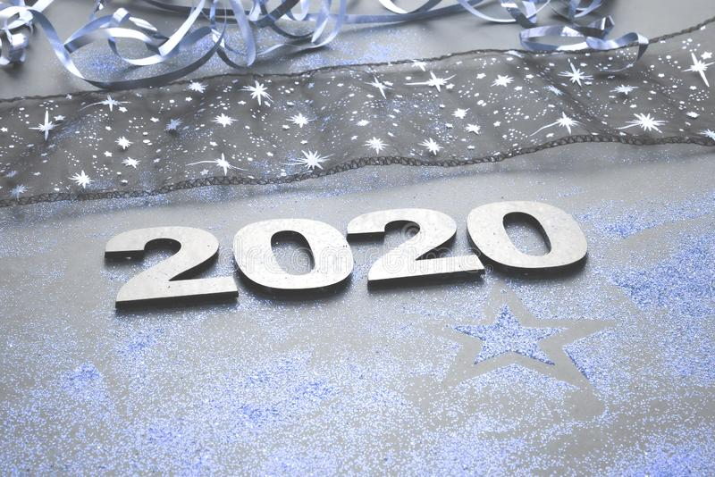 Happy New Year 2020. Symbol from number 2020 on stone background royalty free stock photo