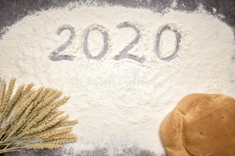 Happy New Year 2020 Happy New Year 2020. Symbol from number 2020 and macaroni on gray cement background royalty free stock photo