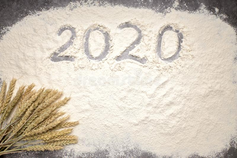 Happy New Year 2020 Happy New Year 2020. Symbol from number 2020 and macaroni on gray cement background royalty free stock images