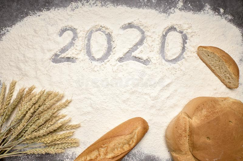 Happy New Year 2020 Happy New Year 2020. Symbol from number 2020 and macaroni on gray cement background stock photos
