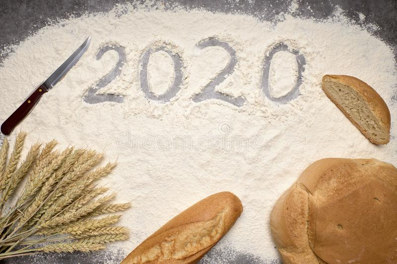 Happy New Year 2020 Happy New Year 2020. Symbol from number 2020 and macaroni on gray cement background stock photo