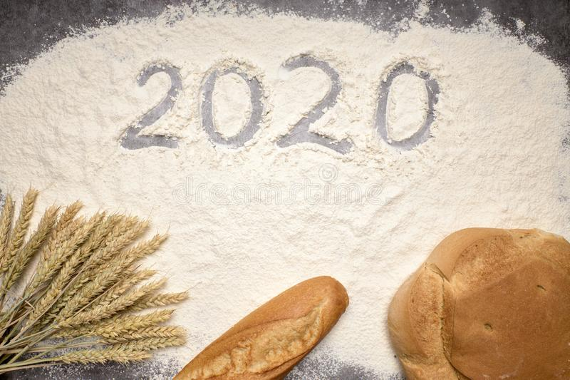 Happy New Year 2020 Happy New Year 2020. Symbol from number 2020 and macaroni on gray cement background royalty free stock image