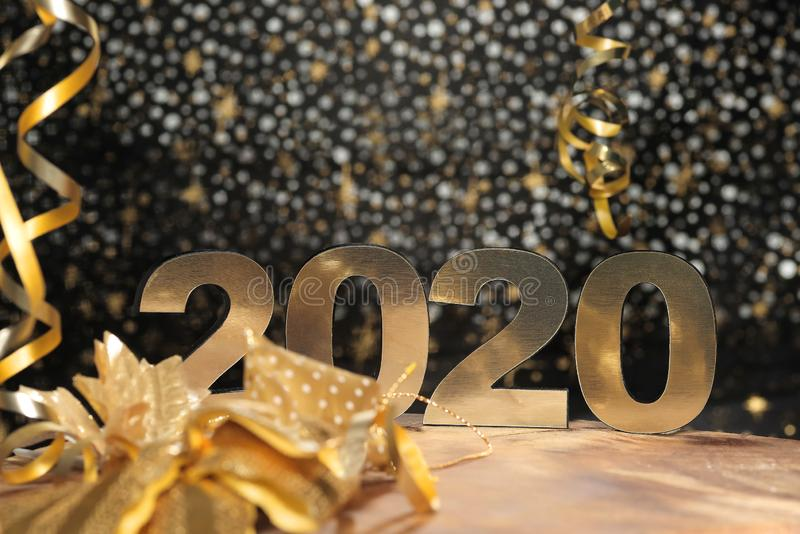 Happy New Year 2020. Symbol from number 2020 on wooden background stock photography