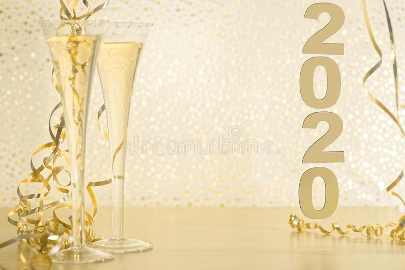 Happy New Year 2020. Symbol from number 2020 on wooden background stock image
