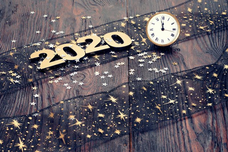 Happy New Year 2020. Symbol from number 2020 on wooden background royalty free stock image