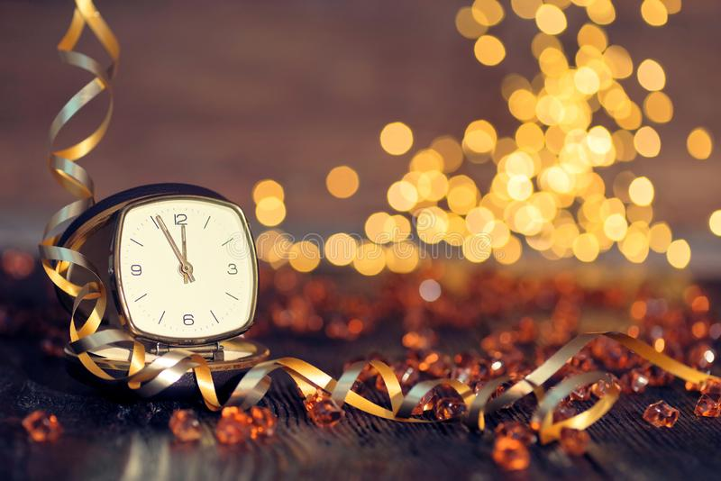 Happy New Year 2020. New year clock on wooden background stock image