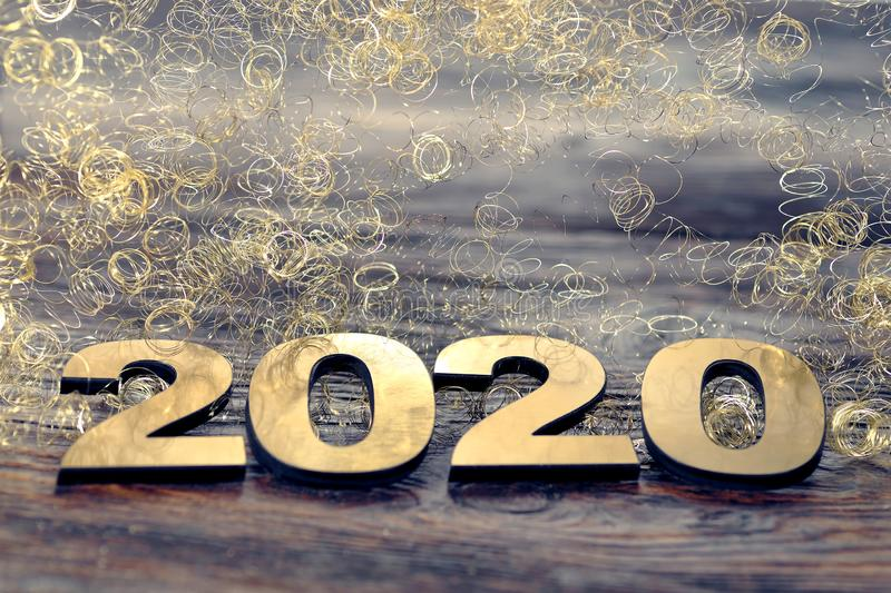 Happy New Year 2020. Symbol from number 2020 on wooden background stock photo