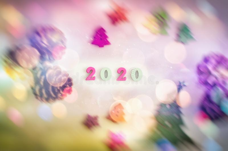 Happy New Year 2020. Symbol from number 2020 on wooden background . Christmas and New Year holidays background with copy space royalty free stock photo