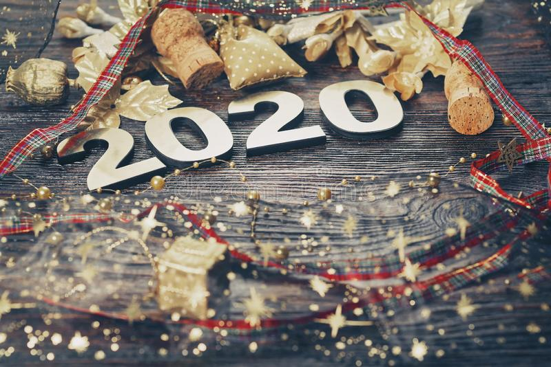Happy New Year 2020. Symbol from number 2020 on wooden background royalty free stock photography
