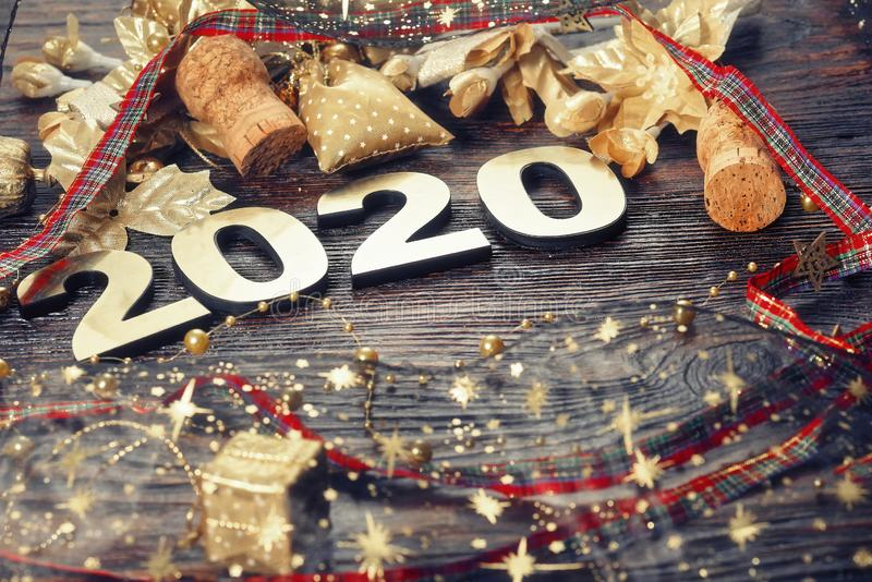 Happy New Year 2020. Symbol from number 2020 on wooden background royalty free stock photo