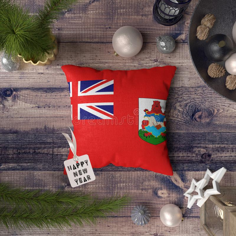 Happy New Year tag with Bermuda flag on pillow. Christmas decoration concept on wooden table with lovely objects.  royalty free stock images