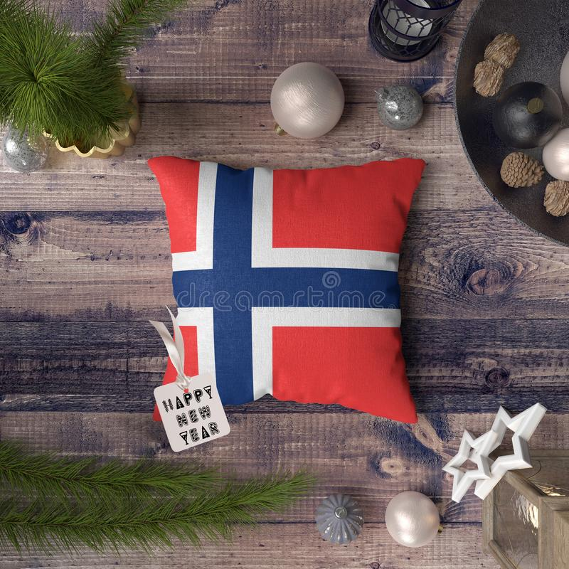 Happy New Year tag with Bouvet Island flag on pillow. Christmas decoration concept on wooden table with lovely objects.  stock photo