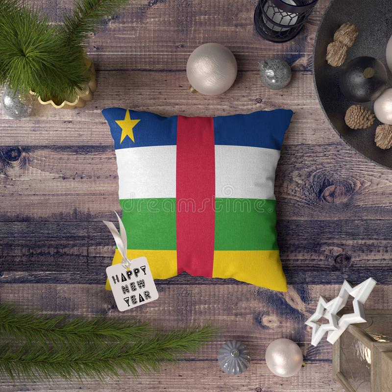 Happy New Year tag with Central Africa flag on pillow. Christmas decoration concept on wooden table with lovely objects.  stock image