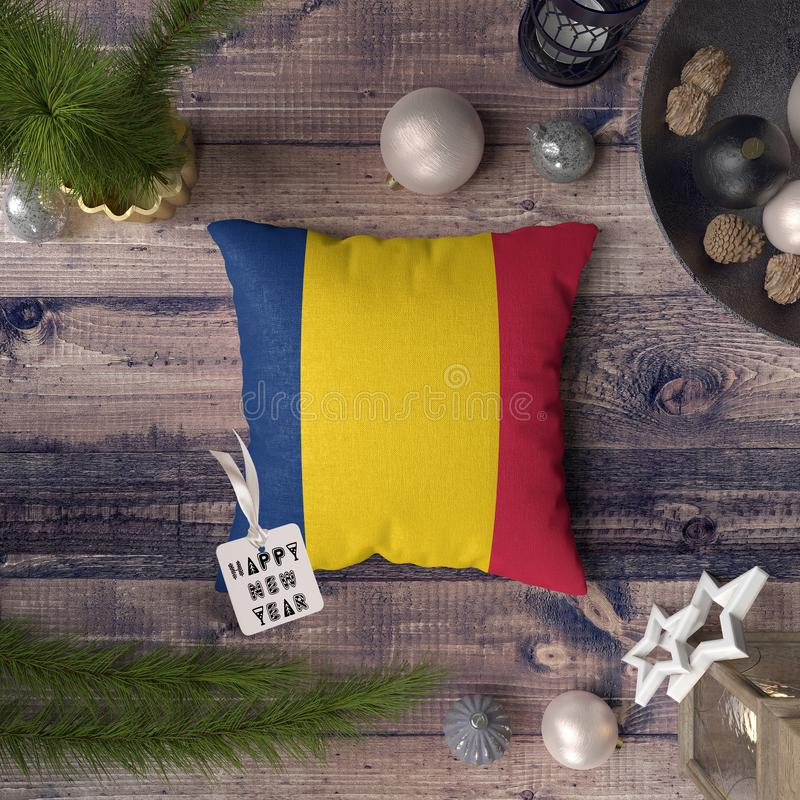 Happy New Year tag with Chad flag on pillow. Christmas decoration concept on wooden table with lovely objects.  royalty free stock photography