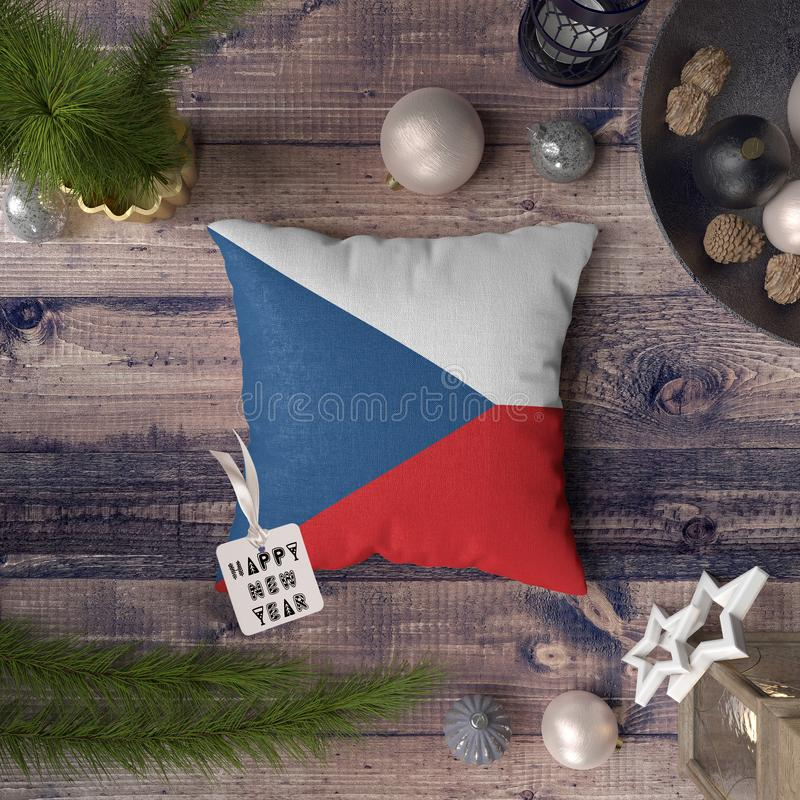 Happy New Year tag with Czech Republic flag on pillow. Christmas decoration concept on wooden table with lovely objects.  stock photos