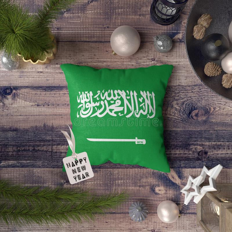 Happy New Year tag with Saudi Arabia Tome and Principe flag on pillow. Christmas decoration concept on wooden table with lovely royalty free illustration