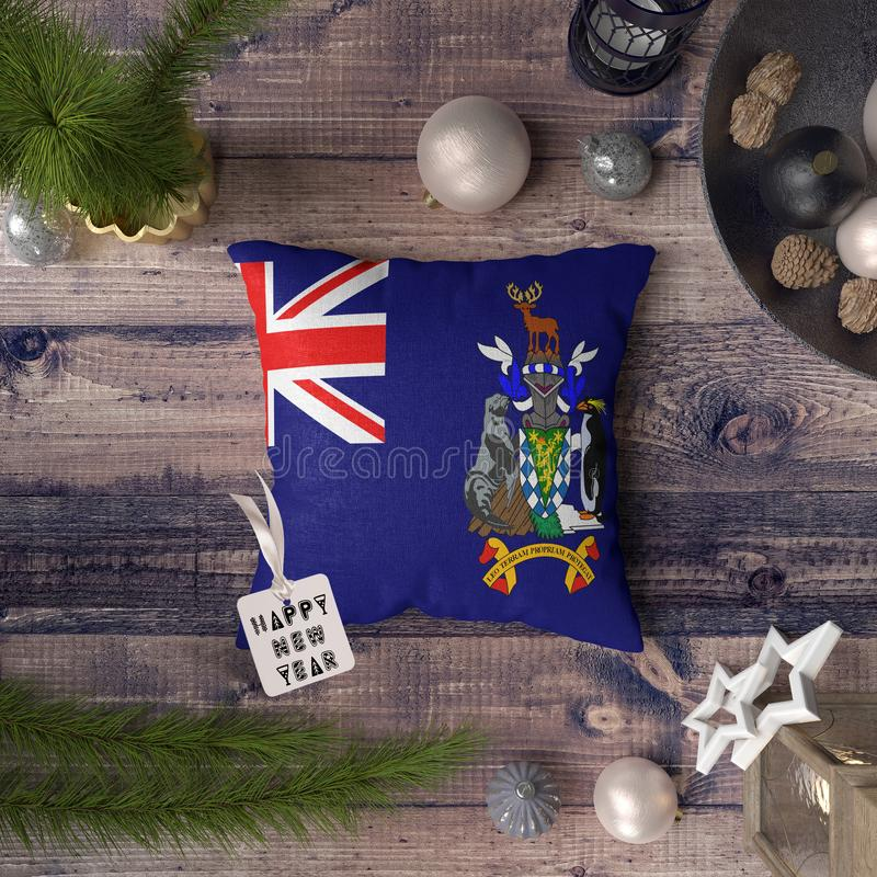 Happy New Year tag with South Georgia and the South Sandwich Islands flag on pillow. Christmas decoration concept on wooden table vector illustration