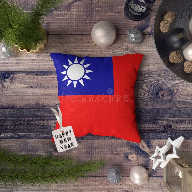 Happy New Year tag with Taiwan flag on pillow. Christmas decoration concept on wooden table with lovely objects royalty free stock photos