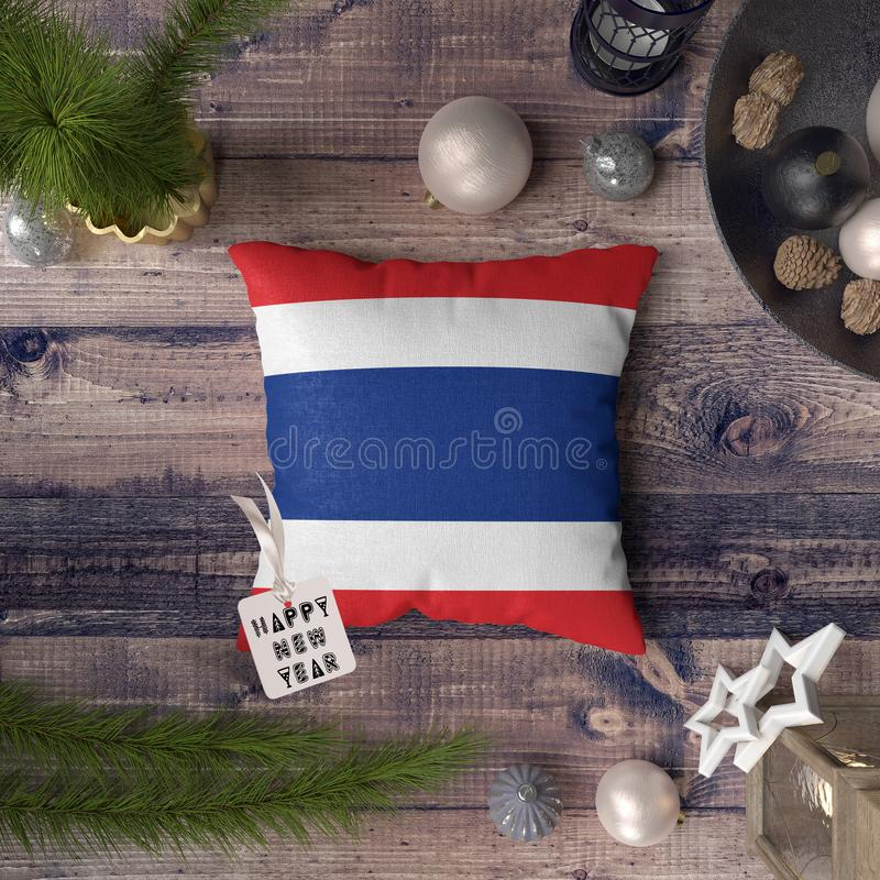 Happy New Year tag with Thailand flag on pillow. Christmas decoration concept on wooden table with lovely objects.  stock photo
