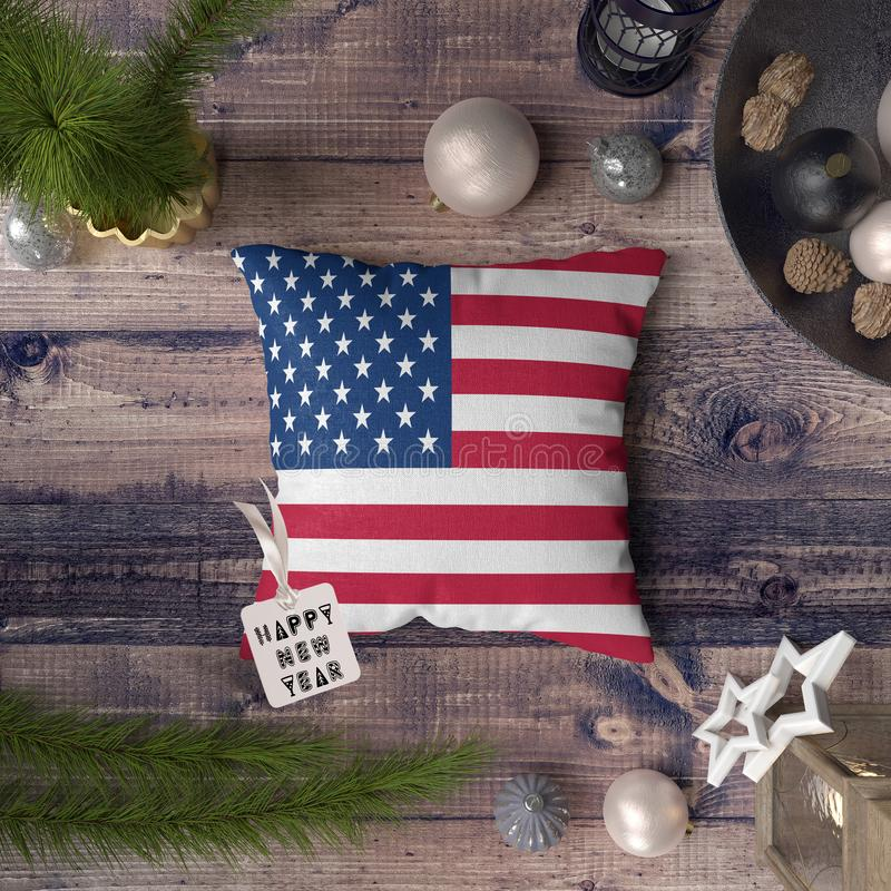 Happy New Year tag with United States flag on pillow. Christmas decoration concept on wooden table with lovely objects.  stock photography