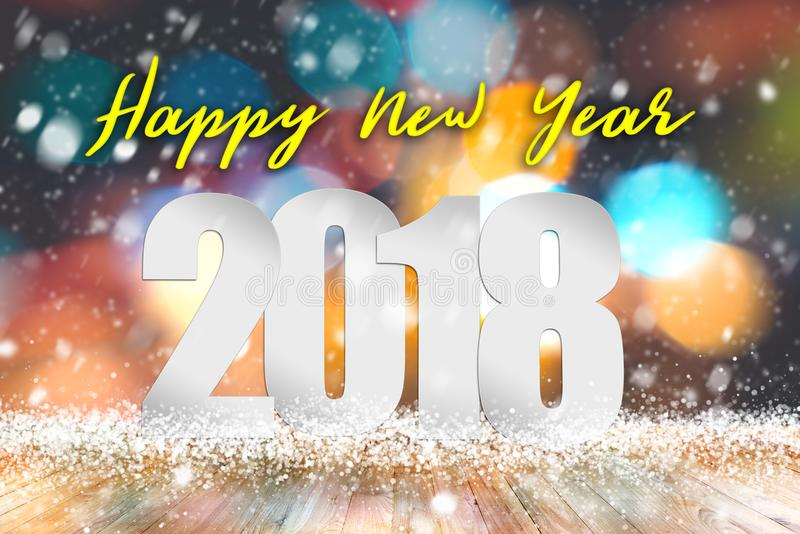 Happy New year 2018 text above empty wood table with snowfall and bokeh light background royalty free stock image