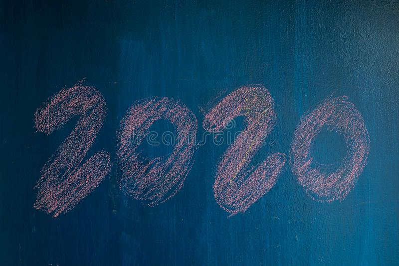 Happy new year 2020 text on blue background. Wooden stock photos