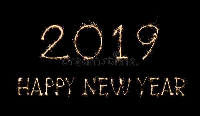 Happy New Year 2019 text handmade written sparkles fireworks stock image