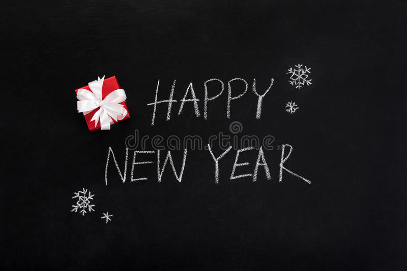 HAPPY NEW YEAR text , handwriting, on blackboard royalty free stock images
