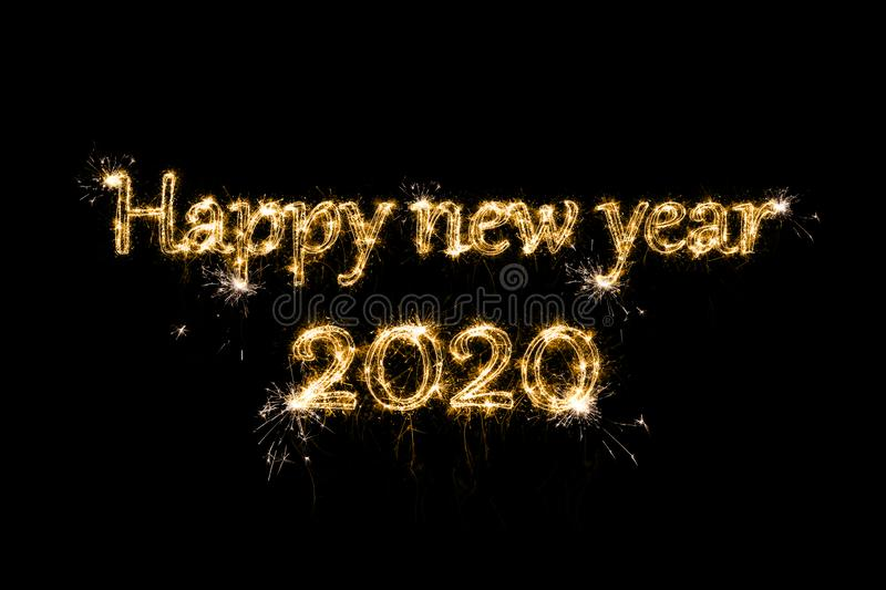 Happy New Year 2020. Text Happy New Year 2020 written sparkling sparklers fireworks isolated on black background. Overlay template for new year, chinese new stock photo