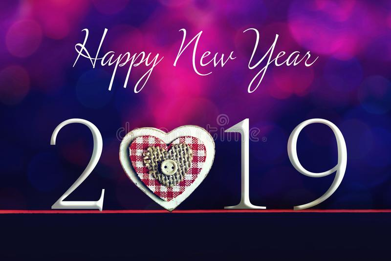 Happy New Year text and heart ornament on blurred background. Happy New Year text and wooden heart ornament on blurred background stock photos