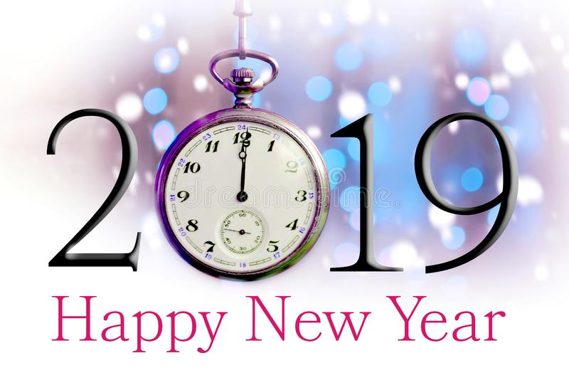 Happy New Year 2019. Text illustration and vintage pocket watch. On blurred background royalty free stock photo
