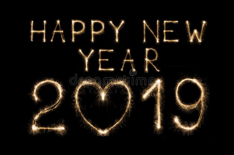 Happy new year 2019 text made from sparklers firework light isolated on black background royalty free stock image
