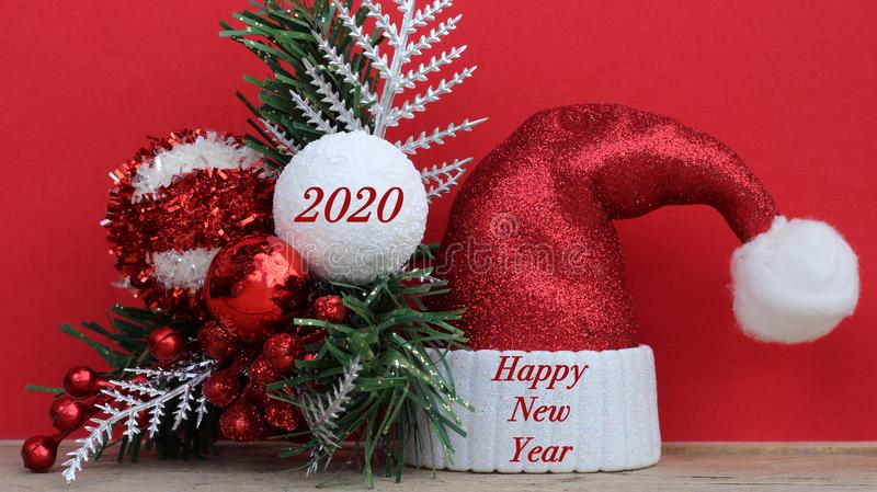 Happy new year text on red and white Santa hat and 2010 in red text on christmas ornament royalty free stock image