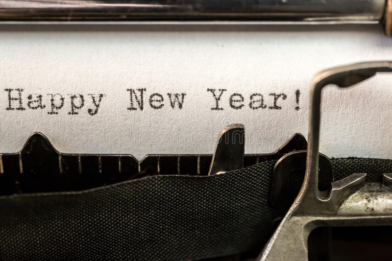 Happy New Year text written by old typewriter. Macro of Happy New Year text written by old typewriter machine royalty free stock image