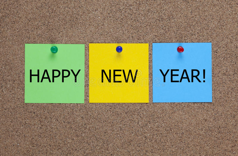 Happy New year!. Three blanks post-it notes on corkboard (bulletin board) with words Â«Happy New Year royalty free stock photo