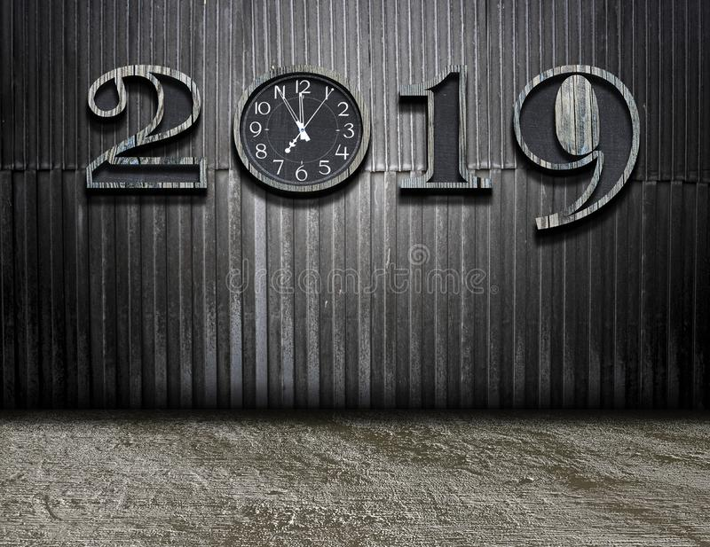 Happy new year 2019 with new timing in life. New years resolution 2019 concept. Wooden year number on dark wall with copy space for your text stock photography
