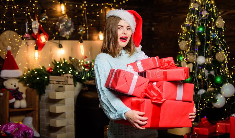 Happy New Year to you. Girl in santa claus hat. Christmas shopping. Christmas tree. Winter holiday. Sexy woman with. Present box. Happy new year. Family royalty free stock images