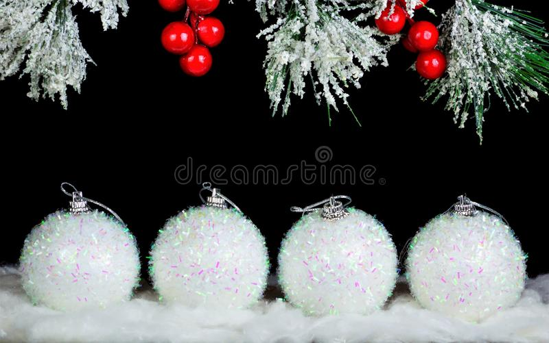 Happy new year-toy Decoration-white sparkling ball, elegant snow-covered fir branch, festive background for creative Christmas stock photography