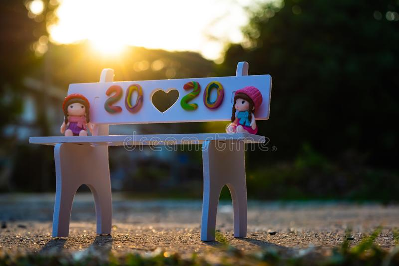 Happy New Year 2020, twenty-twenty numbers on white chair in the garden with beautiful sunlight background. stock image