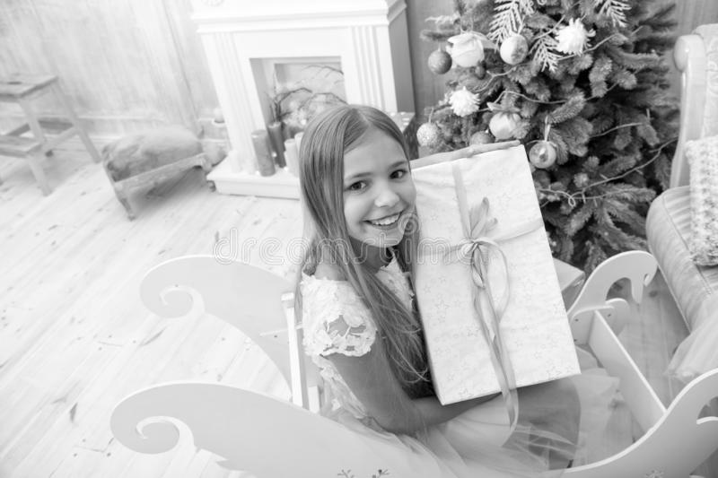Happy new year. Winter. Christmas tree and presents. xmas online shopping. Family holiday. The morning before Xmas. Little girl. Child enjoy the holiday royalty free stock photography
