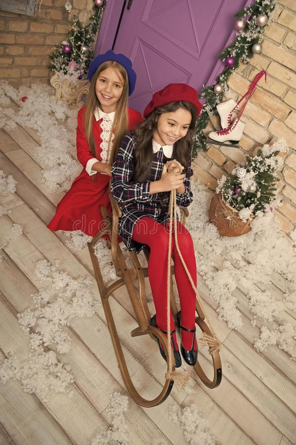 Happy new year. Winter. Christmas tree and presents. xmas online shopping. Family holiday. The morning before Xmas. Little girls on sleigh. Child enjoy the stock images