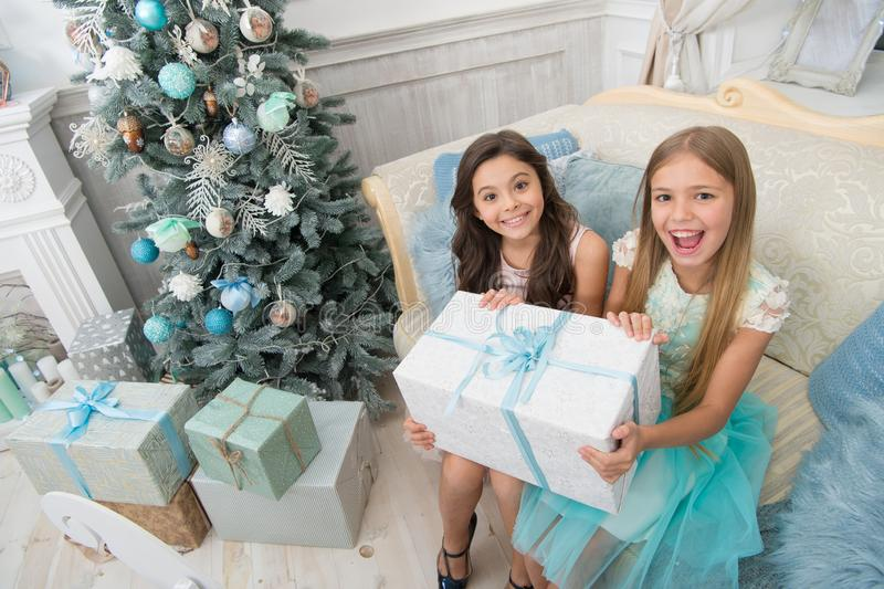 Happy new year. Winter. Christmas tree and presents. xmas online shopping. Family holiday. The morning before Xmas. Little girls. Child enjoy the holiday. Its stock images